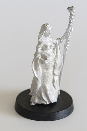 Woman sorceress with stick - pewter figurine.