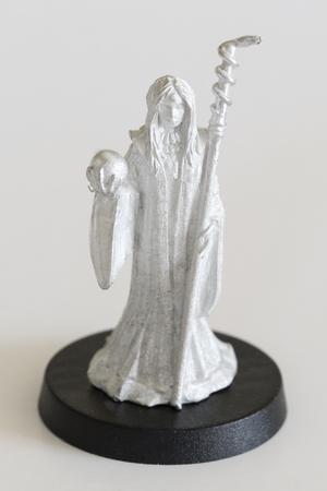 Female witch with cane and crystal ball - tin figure.