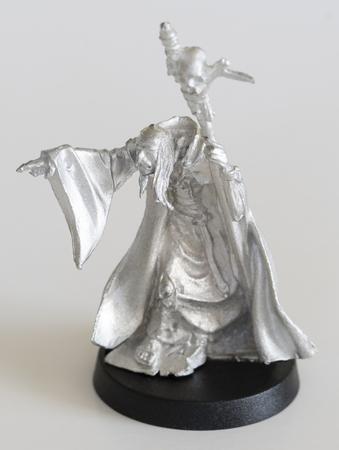 Shaman with stick - tin figure.