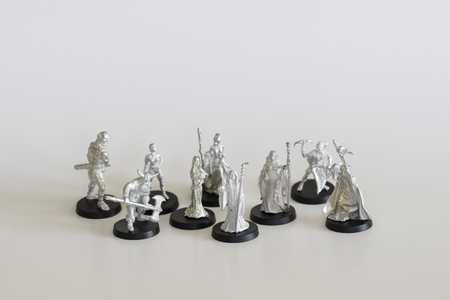 A collection of miniature tin figures from a fantasy game.