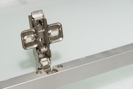 Removed metal door hinge from cabinet. Reklamní fotografie