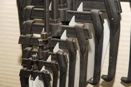 Detail of a set of metal bearing pullers. Stock fotó