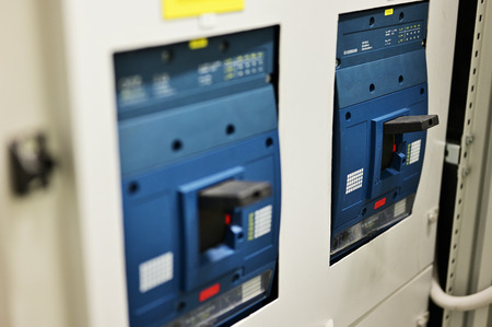 Three-phase circuit breakers in control cabinet. Stok Fotoğraf
