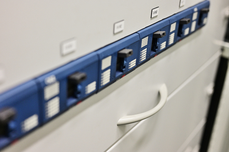 Three-phase circuit breakers in control cabinet. Stock Photo