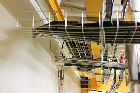 Cables placed on the cable rack in the interior. Stock Photo