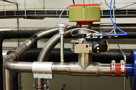Pneumatic valve on the pipe with filter. Reklamní fotografie