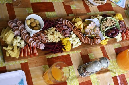 Garnished plate with food on the table outdoors.