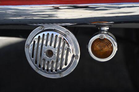 Old horn and blinker in a vintage car.