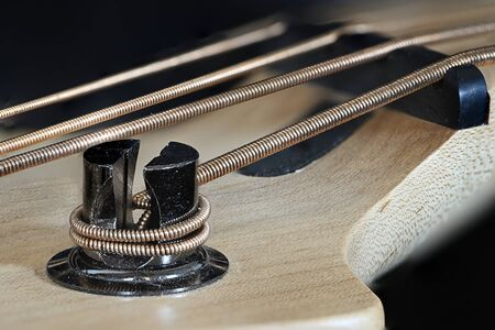 Metal tensioner to string guitar. Stock Photo