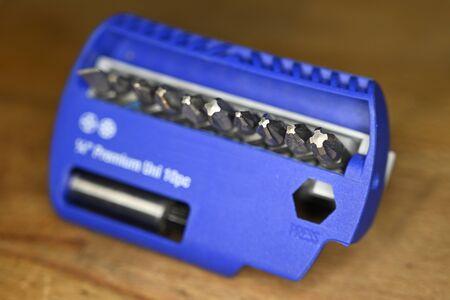 Set of metal bit in blue case. Stock Photo
