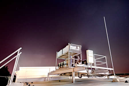 Air conditioning in the evening on the roof with stars. Banco de Imagens