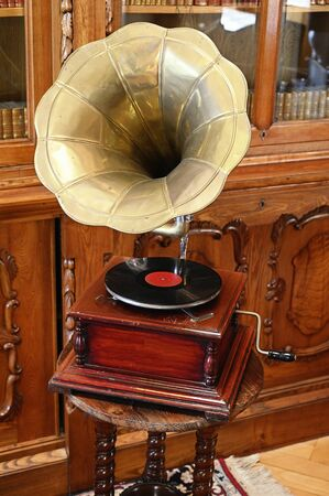 Old turntable with record and handle. 写真素材