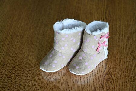 Winter infant footwear with fur.
