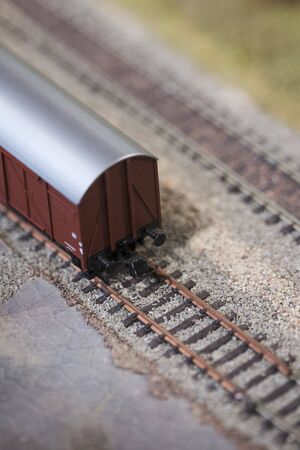 End of freight train model on rails.