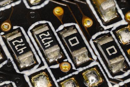 Miniature resistors on computer motherboard. Imagens