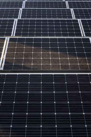 Solar panels on the roof of a building in detail. Stock Photo