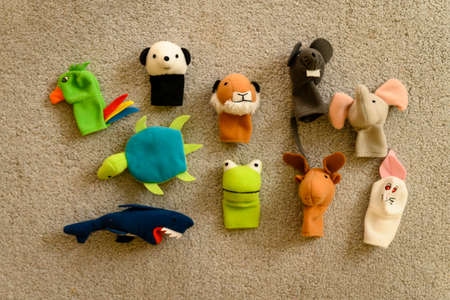 Baby animals plush figurines on a finger.