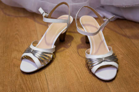 Wedding shoes with a silver trim.