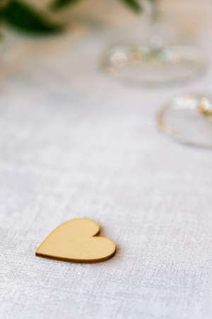Wooden heart lying on the table. Archivio Fotografico