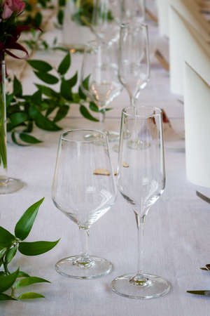 Two clean glasses on the table during the celebration.