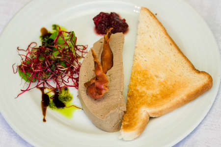 Pate and white toast on a plate. Archivio Fotografico