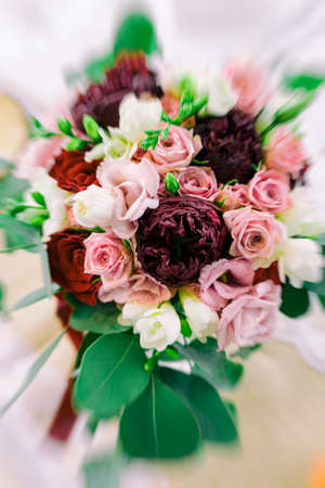 Colorful wedding flower with peonies.