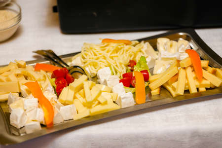 Square tray with different types of cheese. Archivio Fotografico