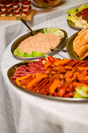 Sausages and a bowl with salmon paste in the background. Archivio Fotografico
