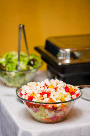 Cheese and tomato cubes in a glass bowl at a celebration. Archivio Fotografico