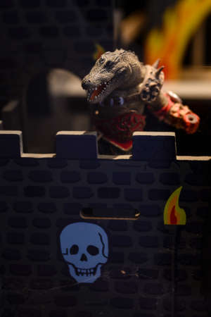 Plastic figurine of a lizard in the castle.