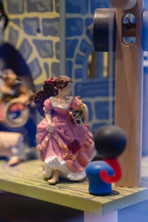 Plastic figurine of a woman in a pink dress. Archivio Fotografico