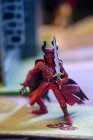 Plastic figurine of a knight with a weapon. Archivio Fotografico