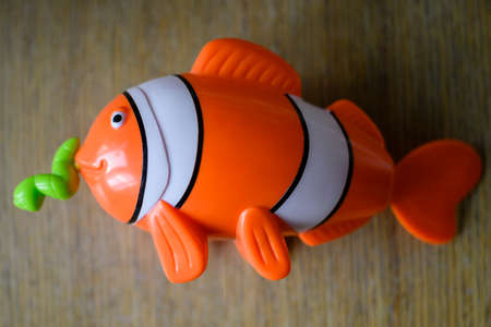 Plastic children's toy with a pulling worm. Banco de Imagens