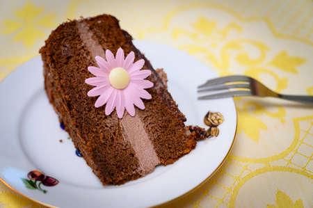 Chocolate cream cake with pink flower. Banco de Imagens