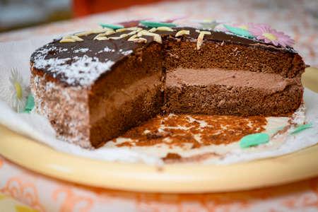 Chocolate cream cake with a triangular slice. Banco de Imagens