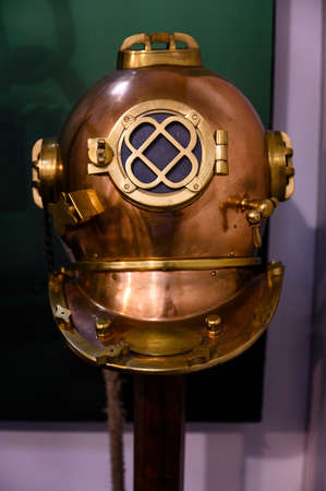 A brass helmet old from a diver.