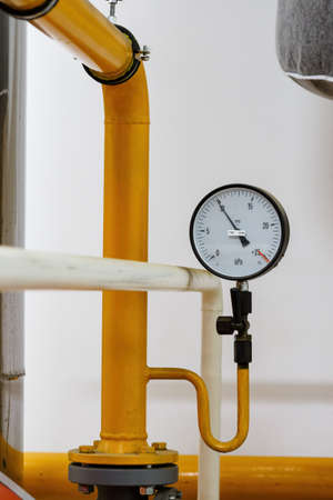 Circular analog pressure gauge with scale on the gas line. Reklamní fotografie