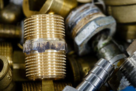 Screwed brass and metal threaded couplings.