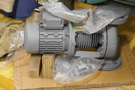 Spare pump with motor partially unpacked.