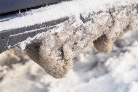 Snow with salt on the car chassis.