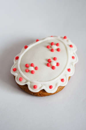 Painted gingerbread eggs on a white background.