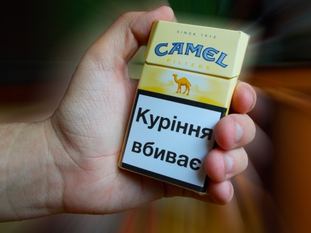 Camel cigarettes with an inscription in Ukrainian smoking kills Stock Photo - 21794990
