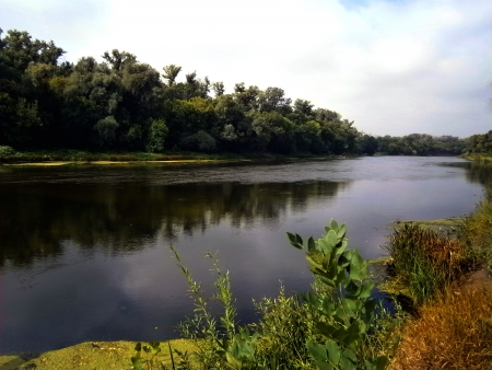 A river landscape of the Seversky Donets and white cloudy sky photo