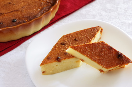 Two slices of cheesecake with raisins photo