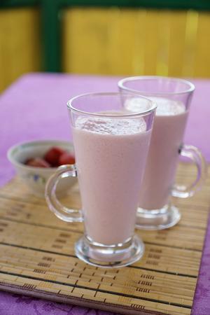 tipple: Milkshake with strawberries in a glass