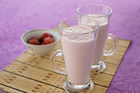 quencher: Milkshake with strawberries in a glass