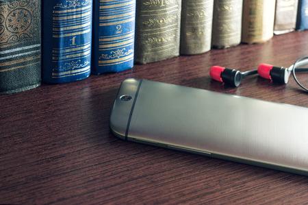 brushed aluminum: smartphone with textured brushed aluminum on the bookshelf