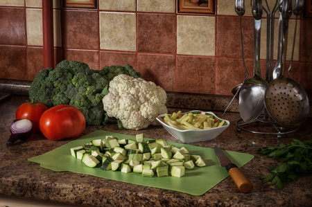 head of cauliflower: Preparation of raw vegetables in the kitchen