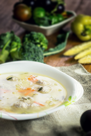 bowl of soup and fresh vegetables