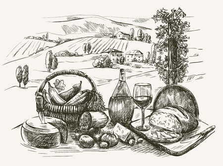 Cheese, wine, bread and vegetables on a table with a view of the mountains